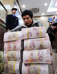 Hà Nội đã nhờ Bắc Kinh in giùm tiền giấy cho Việt Nam từ lâu. (Hình: AFP)